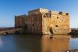 Old castle on Mediterranean sea coast. Paphos, Cyprus. Bright sunset light