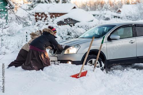 Fotografie, Obraz  two women pushing a car