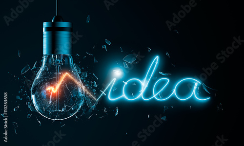 Photo  Exploding light bulb with idea word filament