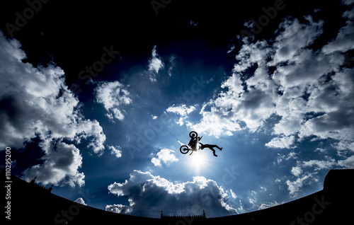 Fotobehang Motorsport Motorcyclist performing a high jump