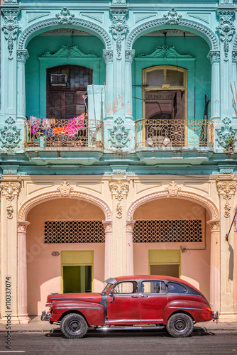 Classic vintage car and coloful colonial buildings in Old Havana, Cuba Canvas Print