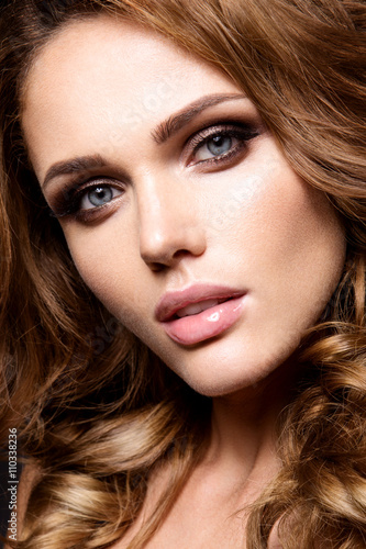 Fotografie, Obraz  Close-up portrait of beautiful woman with bright make-up and curly hair