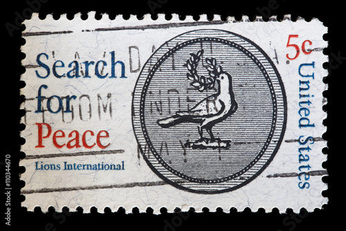 Fotografia  United States used postage stamp showing the dove of Peace