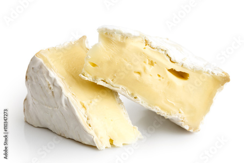 Fototapeta Two pieces of white mould cheese isolated on white. obraz