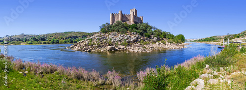 Foto op Plexiglas Kasteel Panorama of the Templar Castle of Almourol and Tagus river. One of the most famous castles in Portugal. Built on a rocky island in the middle of Tagus river.