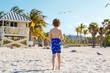 Little kid boy having fun on tropical beach