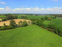 Aerial View Over Green Field...