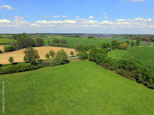 Photo sur Toile Vue aerienne Aerial view over green fields in germany
