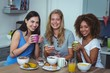 Portrait of multi ethnic friends having coffee at table