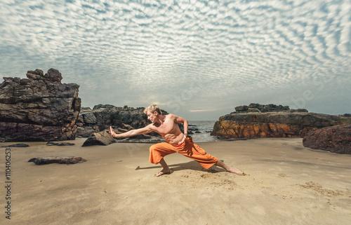 Young man training martial arts Canvas Print