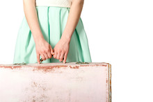 Woman Holding Suitcase At Whit...