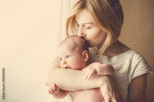 1b4691bcc newborn baby in a tender embrace of mother at the window - Buy this ...