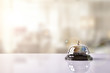 Leinwanddruck Bild - Service bell on hotel reception with Hotel background