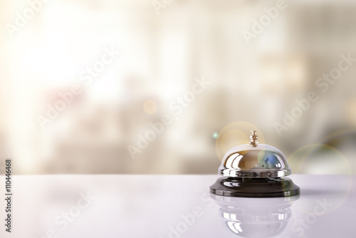 Fotografie, Obraz Service bell on hotel reception with Hotel background