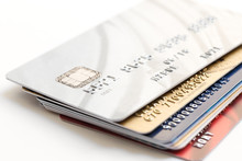 Pile Of Credit Cards On White Background