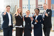 Group Of Businesspeople Showing Thumb Ups
