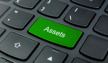 Business Concept: Close-up The Assets Button On The Keyboard And Have Lime, Green Color Button Isolate Black Keyboard