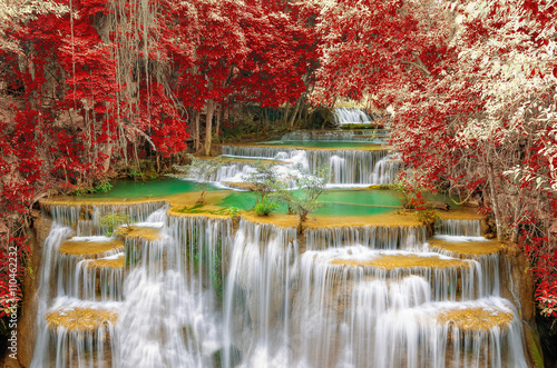 Foto op Canvas Watervallen Waterfall in autumn forest.