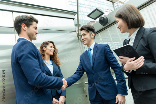Fotografie, Obraz  Business people hand shaking at outdoor