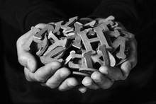 Man With Wooden Letters In His Hands