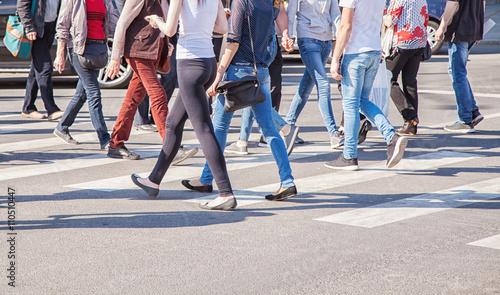 pedestrians walking on a crosswalk Fototapete