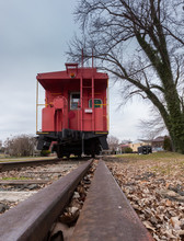 Old Red Caboose With Train Track