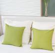 Leinwanddruck Bild green pillows on a bed