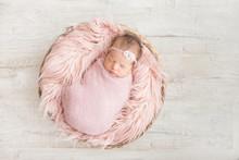 Sleeping Newborn Baby In A Bas...