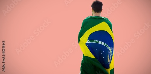 Fotografie, Tablou  Composite image of rear view of brazilian sportsman