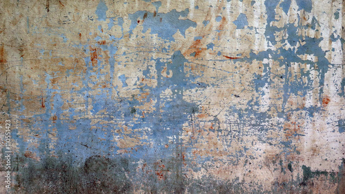 Wide Background In Blue / Background wall with scratched paint and patina. contrasting colors. in Outdoors: natural colors. Havana, Cuba.