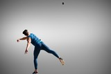 Fototapeta Sport - Composite image of man throwing discus against white background