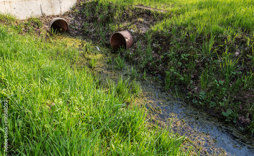 Fotografia, Obraz  dirty wastewater with an algae pass in the downpipes for drainage gutter among g