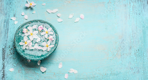 Keuken foto achterwand Spa Beautiful spring blossom with white flowers in water bowl on Turquoise blue shabby chic wooden background, top view. Wellness and spa concept. Spring blossom background, banner