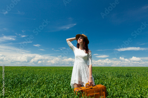 Stampe  young woman with suitcase