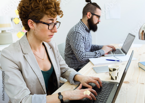 Business people working in the office with laptop.