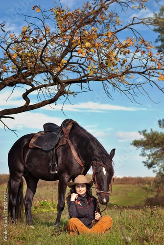 Fotografie, Obraz  woman in a hat and horse under a tree