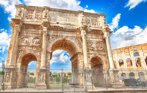 The spectacular Arch of Constantine, located between the Colosseum and the Arch of Titus, built to celebrate the triumph of the emperor Constantine in a sunny day Canvas Print
