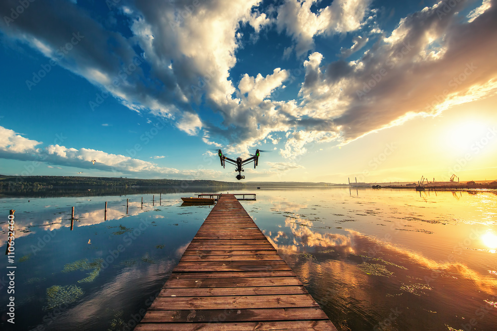 Fototapety, obrazy: Image of drone over the lake, sunset shot