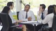 Attractive confident business group discuss ideas in office meeting