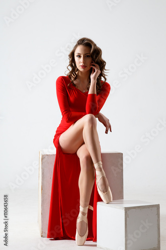c1047c8ed Dancing lady in a red dress. Contemporary modern dance on a white  background isolated. Fitness, stretching model