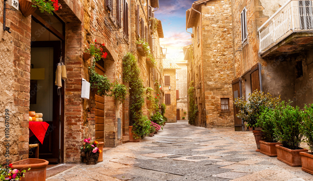Fototapeta Colorful street in Pienza, Tuscany, Italy