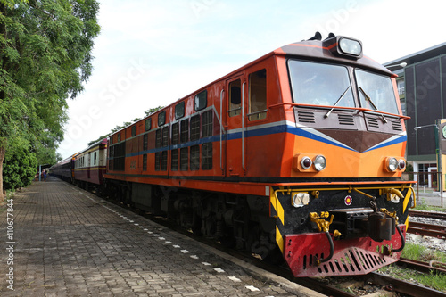Fotografering  orange train on railway station wait to travel