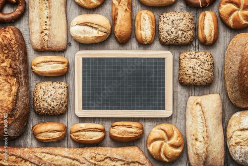 Fotografie, Obraz  Fresh bread and chalkboard