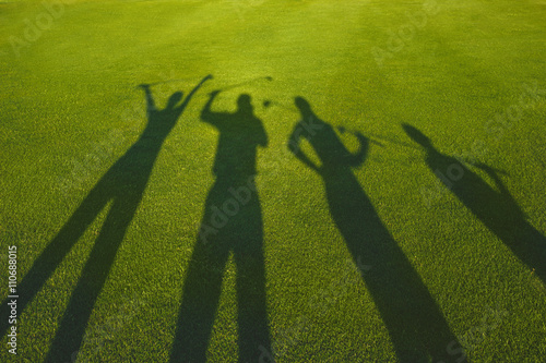 Cadres-photo bureau Golf Four golfers with open hands silhouette on grass