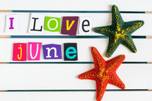 I Love June Written With Color Magazine Letter Clippings On Wooden Board. Summer Vacation Concept