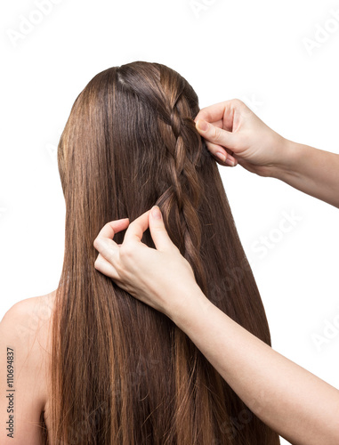 Hands parekmahera braided plait for long hair isolated on white. Canvas Print