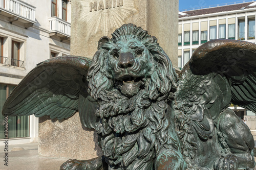 Winged Lion beneath the statue of Daniele Manin in venice Poster