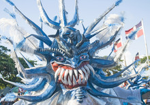 Carnival Monster With Dominican Flags Waving On Background