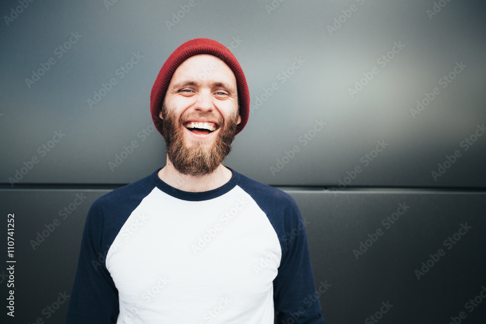 Fototapeta Hipster man smiling and wearing a hat