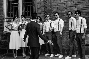 Groom with the groomsmen and bridesmaids